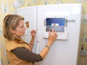 Using portable computer on Refrigerator in Interet Wired Kitchen