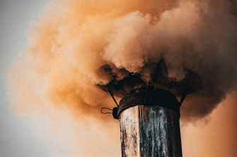 gray tower covered by smoke